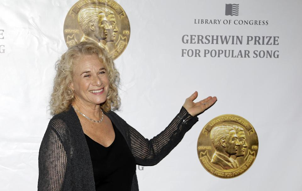 Singer-songwriter Carole King poses for photographers before an event to honor her with the Gershwin Prize for Popular Song, at the Library of Congress, Tuesday, May 21, 2013 in Washington. (AP Photo/Alex Brandon)