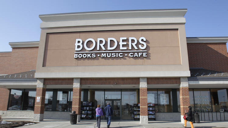 FILE - In this Feb. 16, 2011 file photo, customers walk into a Borders Books & Music store, in Ann Arbor, Mich. Borders Group teetered on the brink of liquidation Thursday, July 14, 2011, after an offer from a private-equity investor disintegrated.  (AP Photo/Carlos Osorio, file)