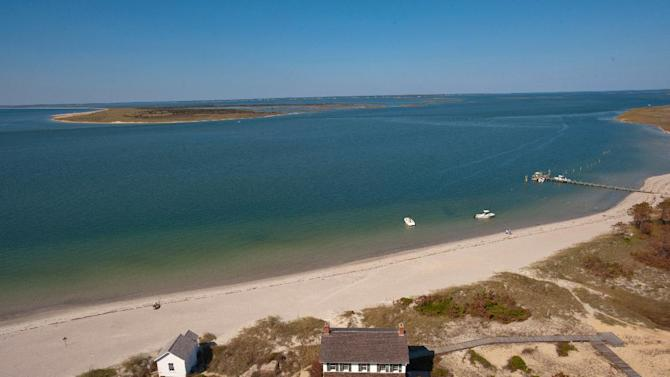 FILE - In an undated file photo provided by VisitNC.com., a view from the top of the Cape Lookout Lighthouse shows the eastern end of Shackleford Banks, part of the Cape Lookout National Seashore. The National Park Service has backed off its proposal to use dredged sand to fight erosion on North Carolina's Shackleford Banks _ pleasing both environmentalists, who want to maintain the barrier island's pristine condition, and local beach town officials, who want the sand for their shores. (AP Photo/VisitNC.com.,Bill Russ, File)