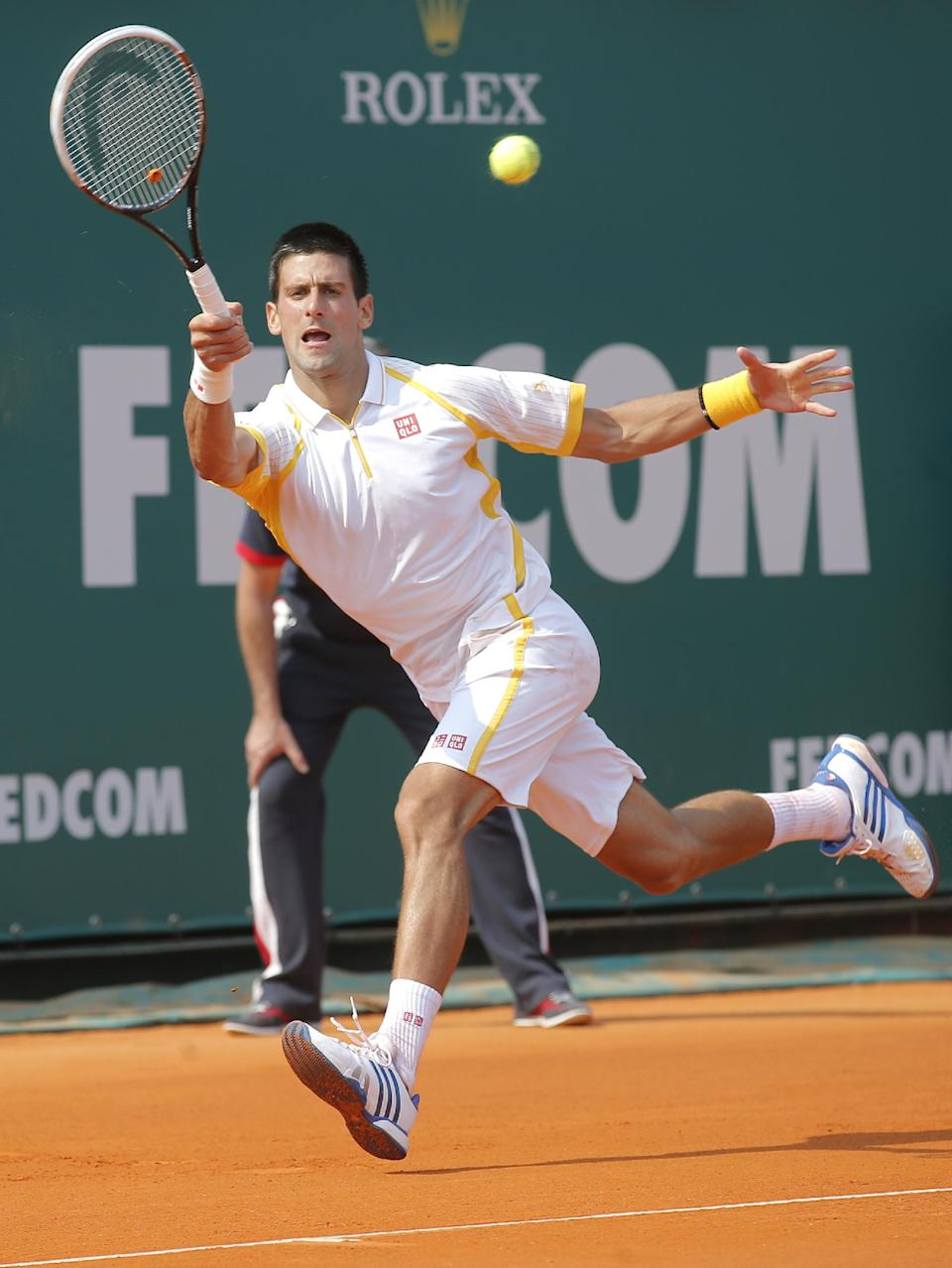 Novak Djokovic of Serbia plays a return to Mikhail Youzhny of Russia during their match of the Monte Carlo Tennis Masters tournament in Monaco, Wednesday, April 17, 2013. (AP Photo/Lionel Cironneau)