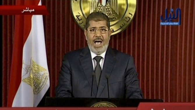 In this image made from video, Egyptian President Mohammed Morsi delivers a televised statement in Cairo, Egypt, Thursday, Dec. 6, 2012. (AP Photo/Nile TV) EGYPT OUT