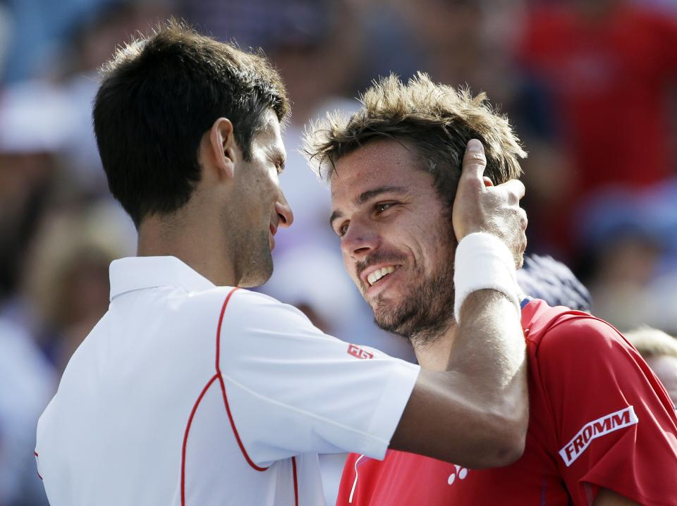 Novak Djokovic, of Serbia, left greets Stanislas Wawrinka, of Switzerland, at the net after beating him in five sets at the semifinals of the 2013 U.S. Open tennis tournament, Saturday, Sept. 7, 2013, in New York. (AP Photo/David Goldman)