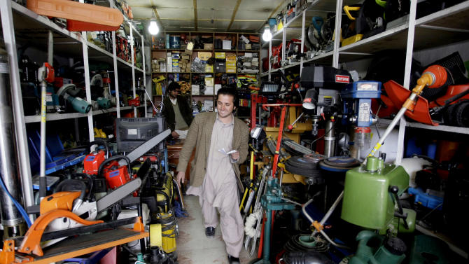 ADVANCE FOR SUNDAY JAN. 27 - In this Tuesday, Jan. 22, 2013 photo, a man leaves a shop that sells Chinese items in Kabul, Afghanistan. China, long a bystander to the bloody conflict in neighboring Afghanistan, is accelerating its involvement as U.S.-led forces prepare to withdraw, attracted by its vast, untapped mineral resources and concerned that post-2014 chaos could fuel its own Islamist insurgents. (AP Photo/Musadeq Sadeq)