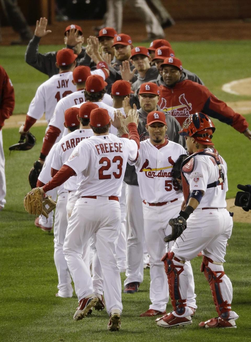 The St. Louis Cardinals celebrate after Game 4 of baseball's National League championship series against the San Francisco Giants Thursday, Oct. 18, 2012, in St. Louis. The Cardinals won 8-3 to take a 3-1 lead in the series. (AP Photo/Mark Humphrey)