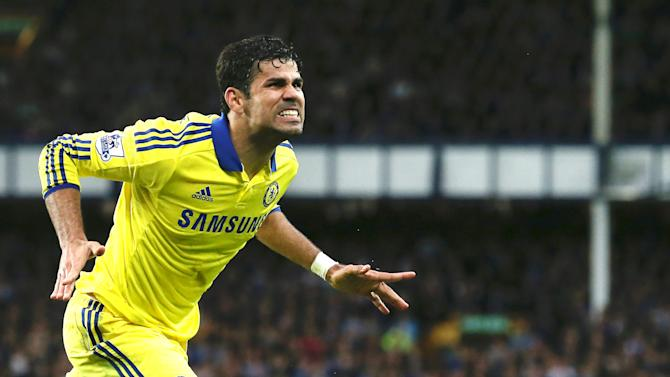 Chelsea's Brazilian-born Spanish striker Diego Costa celebrates scoring his team's sixth goal during the English Premier League football match between Everton and Chelsea at Goodison Park in Liverpool on August 30, 2014