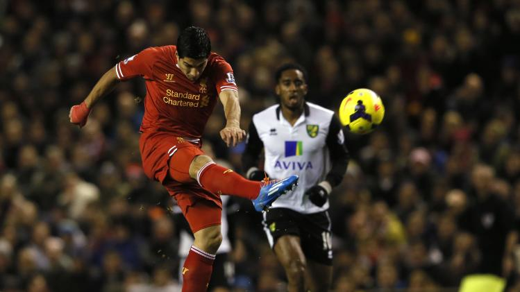 Liverpool's Suarez scores a goal against Norwich during their English Premier League soccer match at Anfield in Liverpool