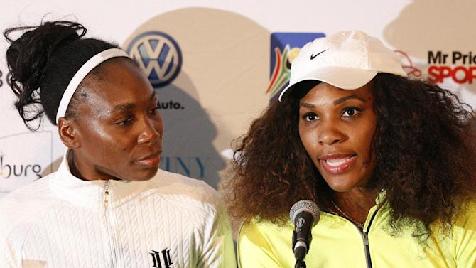 Serena Williams, right, and her sister Venus, left, speak during a news conference after leading a workshop at the Arthur Ashe Tennis Centre in Soweto, South Africa on Saturday Nov. 3, 2012. (AP Photo/Themba Hadebe)