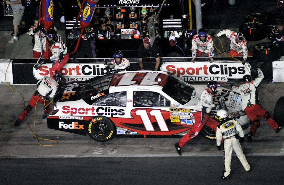 Sprint Cup Series driver Denny Hamlin makes a pit stop during the NASCAR Sprint Cup Series auto race at Atlanta Motor Speedway, Sunday, Sept. 2, 2012, in Hampton, Ga. Hamlin won the race. (AP Photo/Joe Sebo)