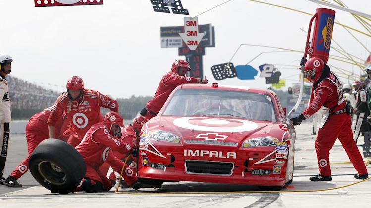 Juan Pablo Montoya (42) makes a pit stop during the NASCAR Sprint Cup Series auto race, Sunday, Aug. 5, 2012, at Pocono Raceway in Long Pond, Pa. (AP Photo/Mel Evans)