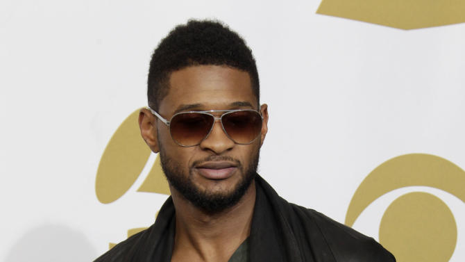 Usher poses backstage with his awards for best male R&B vocal and best contemporary R&B album at the 53rd annual Grammy Awards on Sunday, Feb. 13, 2011, in Los Angeles. (AP Photo/Jae C. Hong)