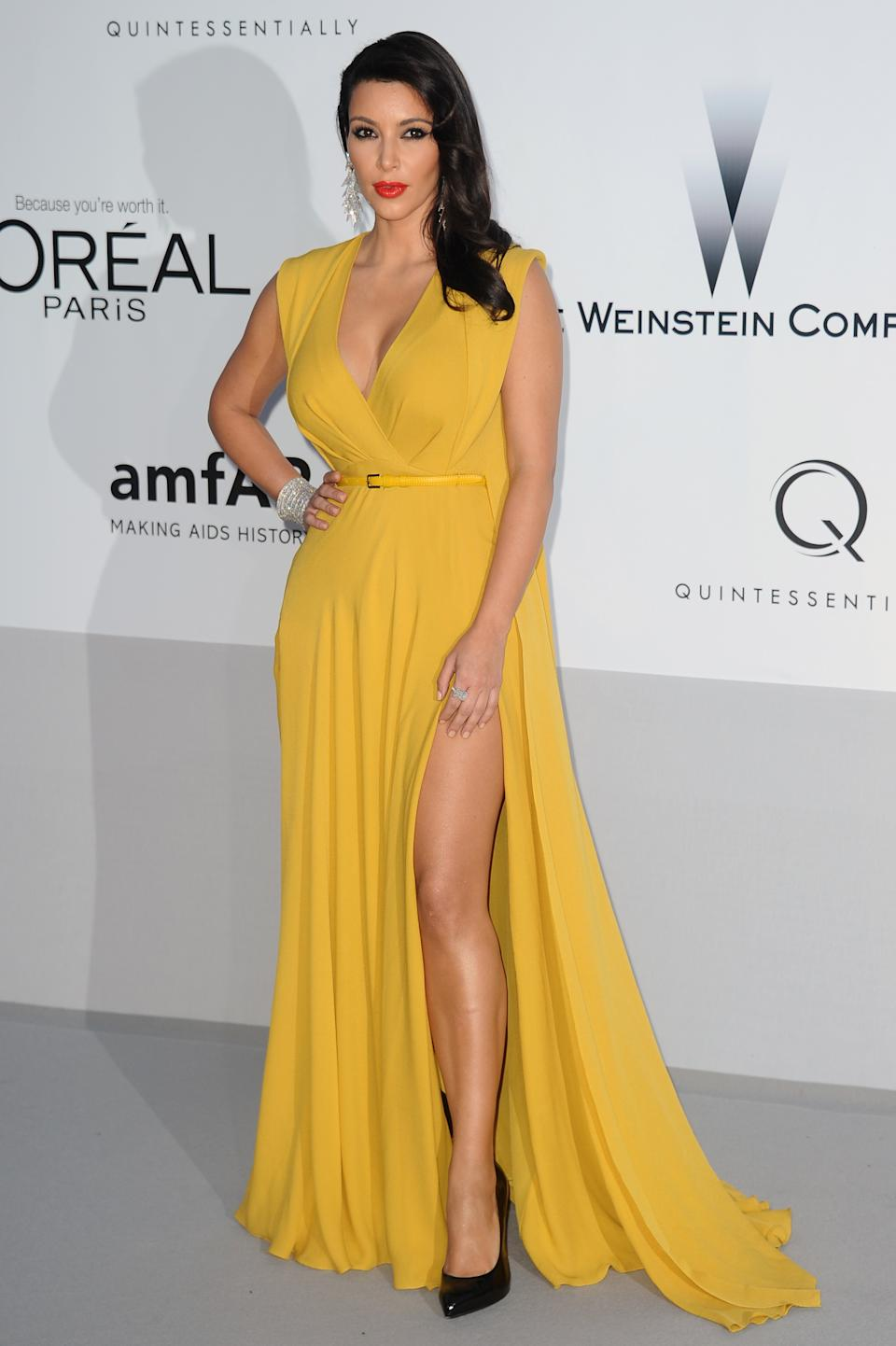 Kim Kardashian arrives for the amfAR Cinema Against AIDS benefit at the Hotel du Cap-Eden-Roc, during the 65th Cannes film festival, in Cap d'Antibes, southern France, Thursday, May 24, 2012. (AP Photo/Jonathan Short)