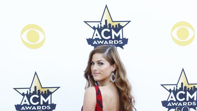 Singer Cassadee Pope poses as she arrives at the 50th Annual Academy of Country Music Awards in Arlington,
