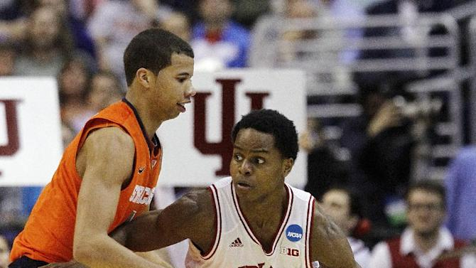 Indiana guard Yogi Ferrell (11) drives around Syracuse guard Michael Carter-Williams, left, during the second half of an East Regional semifinal in the NCAA college basketball tournament, Thursday, March 28, 2013, in Washington. (AP Photo/Pablo Martinez Monsivais)
