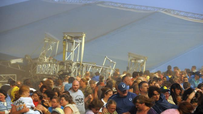 Fans waiting to see Sugarland run away after high winds blew the stage over at the Indiana State Fair Grandstands, Saturday, Aug. 13, 2011, in Indianapolis. About a dozen people are reported to have injuries after the stage collapsed. (AP Photo/The Indianapolis Star, Matt Kryger)