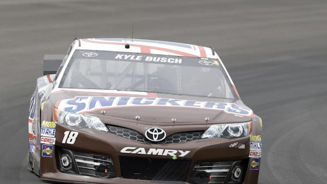 Kyle Busch drives through Turn 1 during the Brickyard 400 auto race at Indianapolis Motor Speedway in Indianapolis, Sunday, July 27, 2014