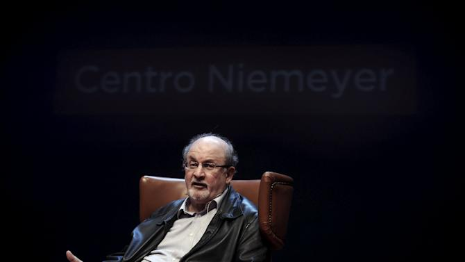 Author Rushdie gestures during a news conference before the presentation of his latest book 'Two Years Eight Months and Twenty-Eight Nights' at the Niemeyer Center in Aviles