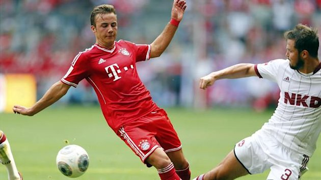 Mario Goetze (L) of FC Bayern Munich is challenged by Per Nilsson of FC Nuremberg during their German first division Bundesliga match in Munich August 24, 2013 (Reuters)