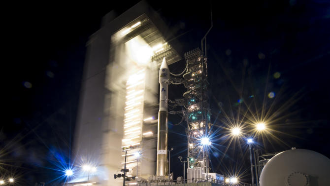 In a photo provided by NASA the launch pad tower at SLC-3 is rolled back to reveal the United Launch Alliance  Atlas-V rocket with the Landsat Data Continuity Mission   spacecraft onboard on Monday, Feb. 11, 2013 at Vandenberg Air Force Base, Calif.  The Landsat Data Continuity Mission  mission is a collaboration between NASA and the U.S. Geological Survey that will continue the Landsat Program's 40-year data record of monitoring the Earth's landscapes from space. The spacecraft is scheduled to launch later today. (AP Photo/NASA,Bill Ingalls)
