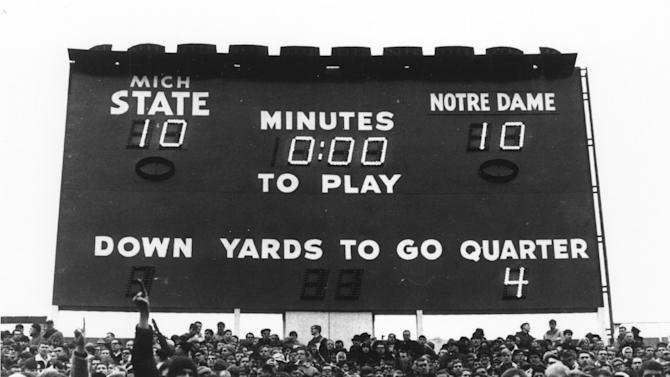 FILE - This Nov. 19, 1966, file photo, provided by Michigan State University shows the Michigan State stadium clock with the final score of an NCAA college football game between Notre Dame and Michigan State in East Lansing, Mich. Notre Dame (9-0-1) was ranked No. 1 by the AP and coaches at the end of the regular season, the only blemish on its record was a 10-10 tie against No. 2 Michigan State. (AP Photo/Michigan State University)