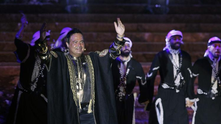"Lebanese singer Assi el Hallani gestures after performing with his dance group in a new-style iteration of the traditional production ""Assi ... Al Helm"" (The Dream) during the opening of the Baalbeck International Festival in Baalbek"