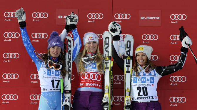 Lindsey Vonn, center, of the United States, winner of an alpine ski women's World Cup super-G, celebrates on the podium with second placed Tina Maze, of Slovenia, left, and third placed Julia Mancuso, of the United States, in St. Moritz, Switzerland, Saturday, Dec .8, 2012. (AP Photo/Giovanni Auletta)