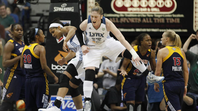Minnesota Lynx forward Maya Moore (23) and guard Lindsay Whalen (13) celebrate after a scoring play against the Indiana Fever in the second half of Game 2 of the WNBA basketball Finals Wednesday, Oct. 17, 2012, in Minneapolis. The Lynx won 83-71. (AP Photo/Stacy Bengs)
