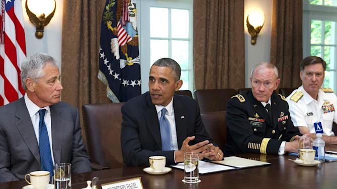 Defense Secretary Chuck Hagel, left, listens to President Barack Obama, next to Joint Chiefs Chairman Gen. Martin Dempsey, and Vice Chief of Naval Operations Adm. Mark Ferguson, during a meeting of service secretaries, service chiefs, and senior enlisted advisers to discuss sexual assault in the military in the Cabinet Room of the White House in Washington, Thursday, May 16, 2013. (AP Photo/Jacquelyn Martin)