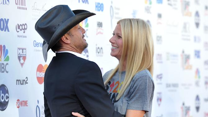 """Musician Tim McGraw, left, embraces actress Gwyneth Paltrow at """"Stand Up to Cancer"""" at the Shrine Auditorium on Friday, Sept. 7, 2012 in Los Angeles. The initiative aimed to raise funds to accelerate innovative cancer research by bringing new therapies to patients quickly. McGraw and Paltrow starred as a married couple in the film """"Country Strong.""""  Paltrow's father Bruce died from cancer in 2002. (Photo by John Shearer/Invision/AP)"""