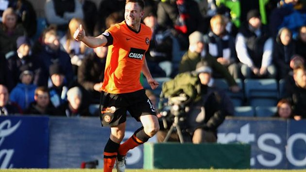 Keith Watson celebrates opening the scoring against Dundee
