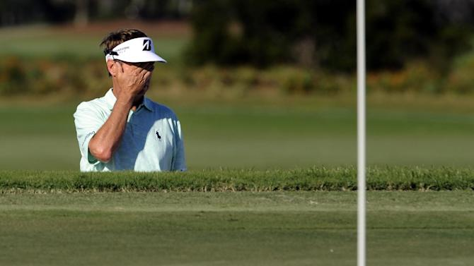 Davis Love III reacts after hitting from the bunker on the 15th green during the final round of the McGladrey Classic PGA Tour golf tournament on Sunday, Oct. 21, 2012, in St. Simons Island, Ga. (AP Photo/Stephen Morton)