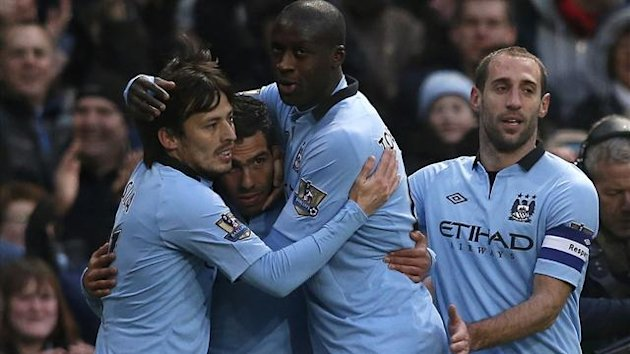 Manchester City's Carlos Tevez (2nd L) celebrates with teammates (Reuters)