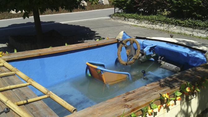 The photo provided by the police in Chemnitz on June 23, 2013 shows a car that has been converted into a driveable pool in Eibenstock, eastern Germany. Young people from the Erzgebirge mountains have converted their car into a pool. Four people fled from the car when it was stopped by a police officer. (AP Photo/Polizei Chemnitz)