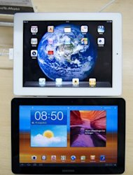 "<p>A Samsung Galaxy Tab 10.1 is pictured under an Apple iPad 2 at the Media Markt in The Hague in 2011. South Korea's Samsung won a patent battle Monday against US rival Apple, with a British judge ruling that Samsung's Galaxy tablet was not ""cool"" enough to be confused with Apple's iPad.</p>"