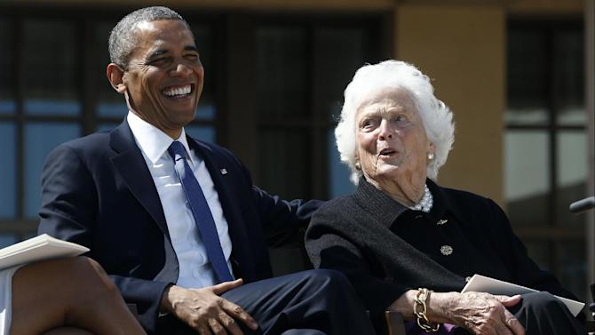 President Barack Obama shares a laugh with former first lady Barbara Bush at the dedication of the George W. Bush presidential library on the campus of Southern Methodist University in Dallas, Thursday, April 25, 2013. (AP Photo/Charles Dharapak)