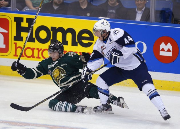 Saskatoon Blades' Dietz and London Knights' Rupert battle for the puck during the Memorial Cup Canadian Junior Hockey Championships in Saskatoon