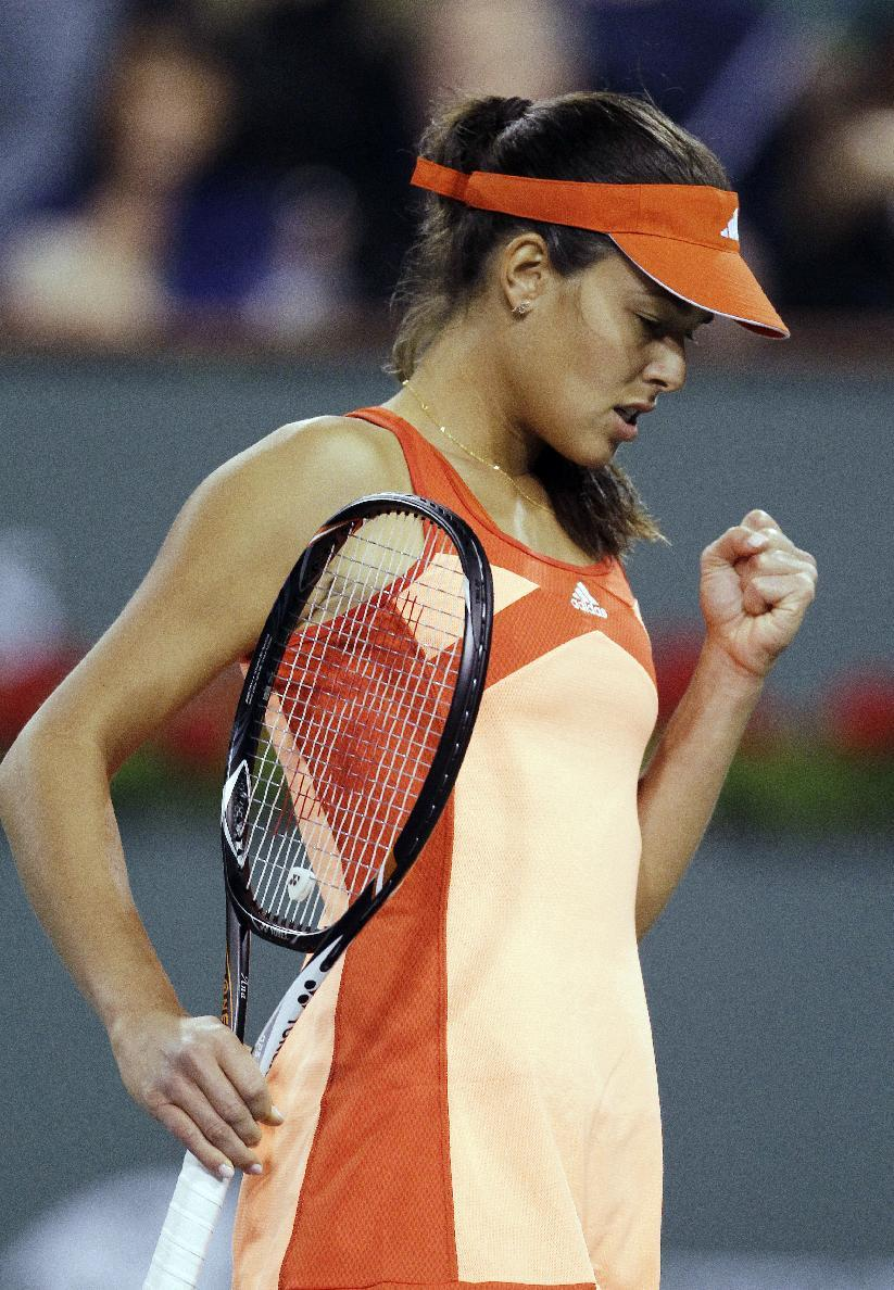 Ana Ivanovic, of Serbia, reacts after breaking the serve of Maria Sharapova, of Russia, during a women's semifinal match at the BNP Paribas Open tennis tournament, Friday, March 16, 2012, in Indian Wells, Calif. (AP Photo/Darron Cummings)