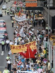 Activists attend a demonstration over a group of disputed islands known as the Diaoyu in Chinese and the Senkaku in Japanese, as they make their way to the Japanese consulate in Hong Kong on September 16