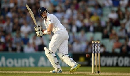 England's Root hits out during the fifth Ashes cricket test match against Australia at the Oval cricket ground in London
