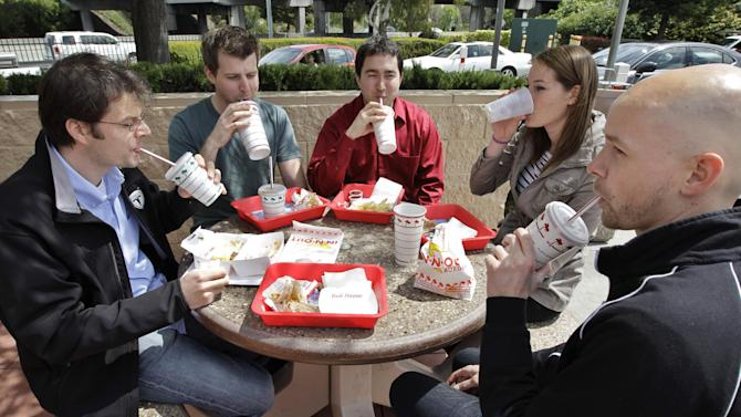Tesla Motors workers take a lunch break together at In-N-Out Burger restaurant in Mountain View, Calif., Thursday, April 12, 2012. In a case that affects thousands of businesses and millions of workers, the California Supreme Court ruled Thursday that employers are under no obligation to ensure that workers take legally mandated lunch breaks. (AP Photo/Paul Sakuma)