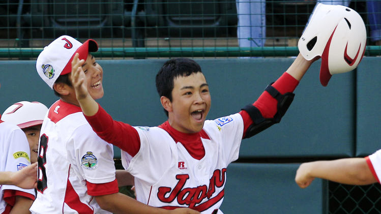 Tokyo's Noriatsu Osaka, right, celebrates with Satoru Aoyama, left, after hitting a walk-off, two-run home run against Goodlettsville, Tenn., in the fifth inning of the Little League World Series championship baseball game in South Williamsport, Pa., Sunday, Aug. 26, 2012. Tokyo won 12-2 in five innings. (AP Photo/Gene J. Puskar)
