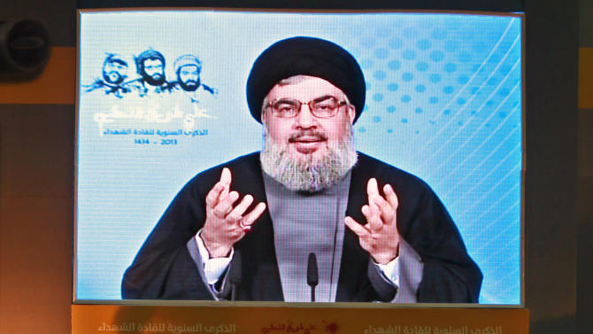 "Hezbollah leader Sheik Hassan Nasrallah speaks via a video link, during a ceremony to mark the anniversary of the death of Hezbollah leaders, in the southern suburbs of Beirut, Lebanon, Saturday, Feb. 16, 2013. Nasrallah has refused to comment on a Bulgarian report that said its members carried out an attack that killed five Israeli tourists in the European nation and he said the ""issue is being followed calmly and carefully."" (AP Photo/Bilal Hussein)"