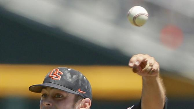 Oregon State starting pitcher Ben Wetzler throws against Louisville in the first inning of an NCAA College World Series baseball game in Omaha, Neb., Monday, June 17, 2013. (AP Photo/Nati Harnik)