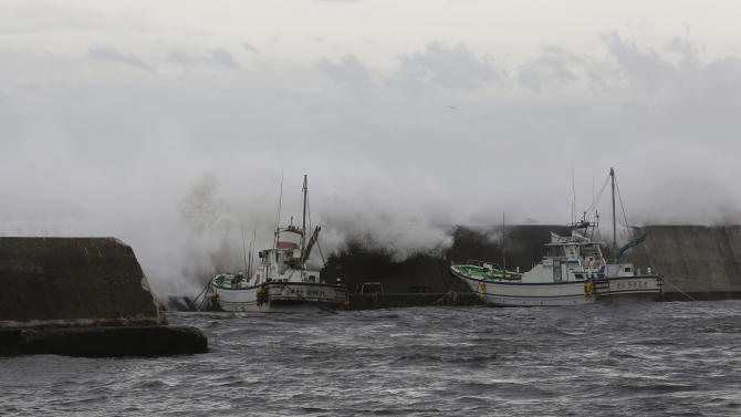 Powerful typhoon downgraded after lashing Japan