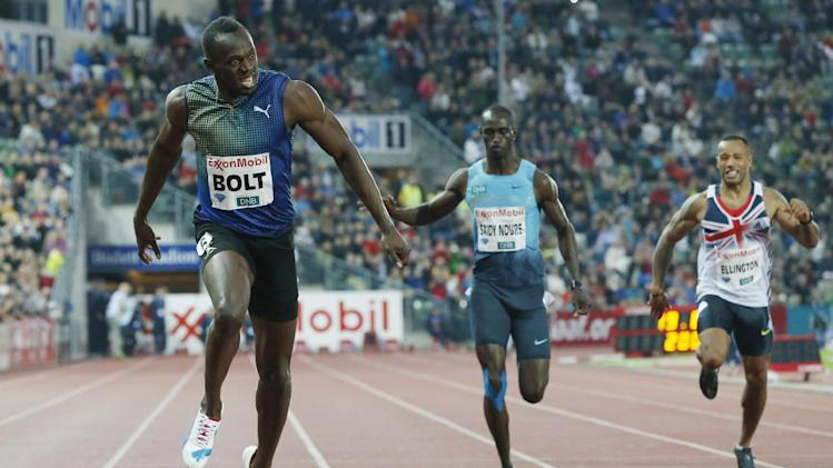 REPEAT FOR IMPROVED TONAL QUALITY - Usain Bolt of Jamaica, left, competes in and wins the men's 200 metres during the Diamond League athletics competition at the Bislett Stadium in Oslo, Thursday June 13, 2013. (AP Photo/NTB Scanpix, Cornelius Poppe)  NORWAY OUT