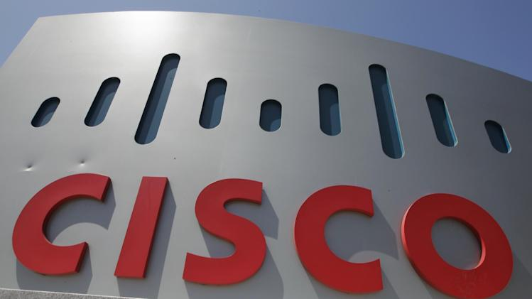 FILE - This Wednesday, May 9. 2012, file photo, shows an exterior view of Cisco headquarters in Santa Clara, Calif. Cisco Systems Inc., reports quarterly eanrings on Wednesday, Nov. 13, 2013. (AP Photo/Paul Sakuma, File)