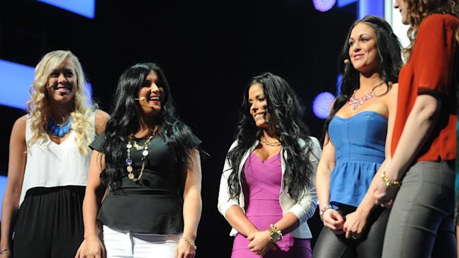 """The cast from """"Nurse Nation"""" Crystal, Michelle, Chelsey and Heather presenting the fall lineup at the 2013 MTV Upfront, on Thursday, April 25, 2013 at the Beacon Theater in New York. (Photo by Scott Gries/Invision/AP Images)"""