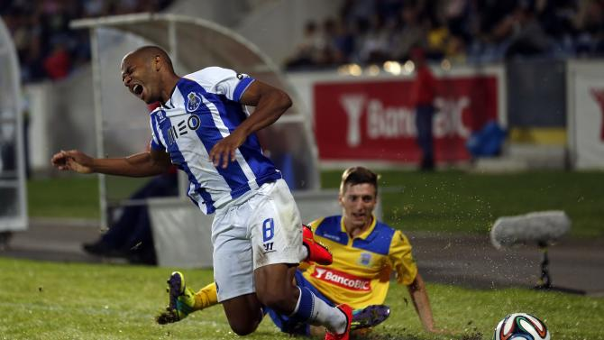 Porto's Yacine Brahimi is tackled by Arouca's Ivan Balliu during their Portuguese premier league soccer match in Arouca