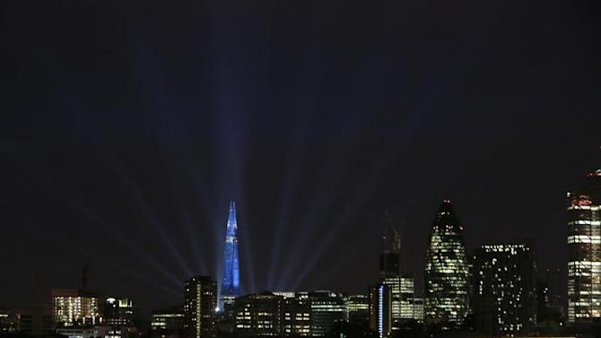 A laser and searchlight show marks the completion of the exterior of the Shard building in central London