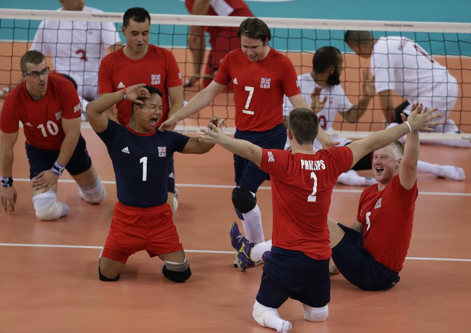 Britain's players celebrate a point against Morocco at a sitting volleyball preliminary round pool A match at the 2012 Paralympics in London, Sunday, Sept. 2, 2012. (AP Photo/Lefteris Pitarakis)