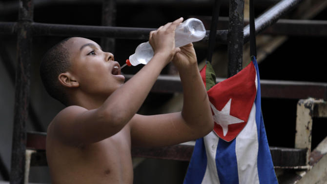 Yassian Salazar, 11, drinks water after training at the Rafael Trejos boxing gym in Old Havana, Cuba, early Thursday, March 21, 2013. Cuba devotes a considerable amount of its scant resources to developing amateur talent and has punched above its weight at international competitions, scoring relatively high in the medal tables for a nation of around 11 million people. (AP Photo/Franklin Reyes)